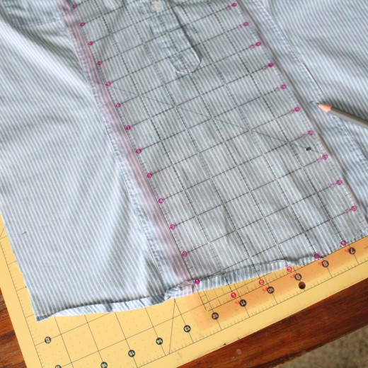 Mark the shirt  16 1/2 inches down in two different places.