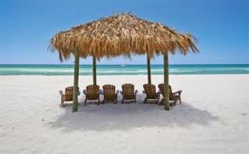Relaxing in the sun on the beach is a great way to spend a spring break. Cabanas are a great beach splurge that  allows you to get in and out of the sun and it gives an area to store your things.