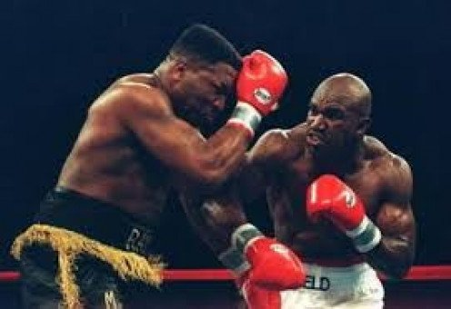 Evander Holyfield puts Ray Mercer on the mat and wins a decision during their sensational ring tussle. It was close throughout but The Real Deal gritted it out and won a decision.
