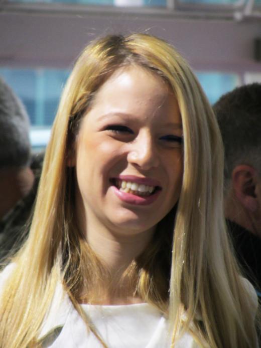 A cheerful girl at motorshow