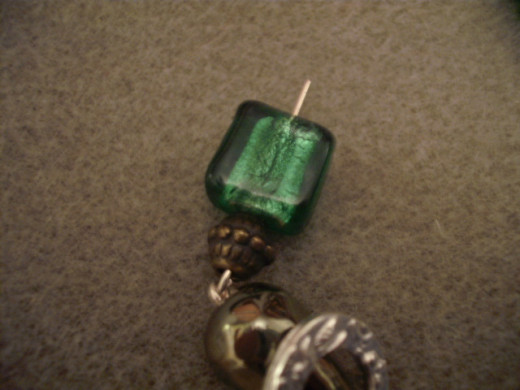 Place beads on the second headpins.