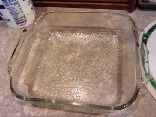 Step One: Prepare a square casserole dish by spraying it generously with cooking spray