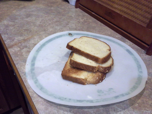 Step Sixteen: Pull out your toasted bread pieces and lay them on your cutting board