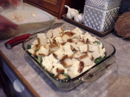 "Step Eighteen: Pour your ""croutons"" over the top of your casserole"