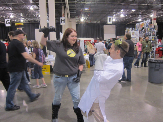 """""""Captain Hammer"""" threatens to punch out """"Dr. Horrible"""" at Motor City Comic Con 2013."""