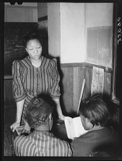 School teachers and pupils in African American rural school.