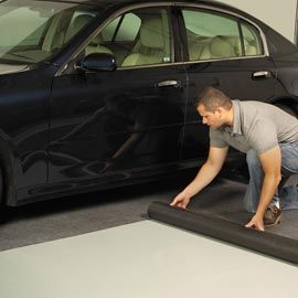 Roll-out garage mats are durable and quick to install.