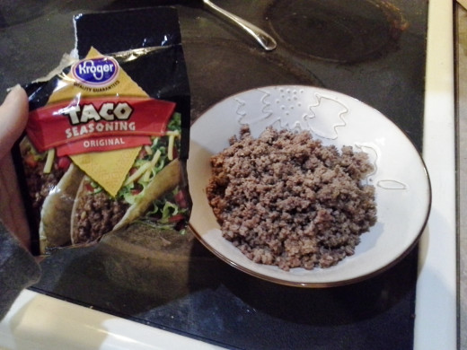 Step Six: Pour your hamburger into a bowl and season it with taco seasoning