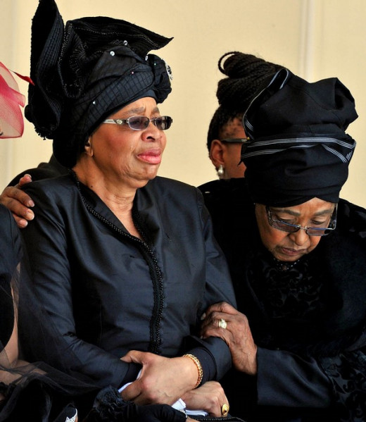 Nelson Mandela's widow Graca Machel is comforted at his funeral by his former wife, Winnie Madikizela-Mandela.