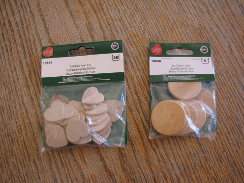 Wood coins come in different shapes. You can purchase heart or circle shaped pieces, or whatever your local craft store has in stock.