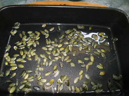 Roast the pumpkin seeds in a single layer, in a little oil.