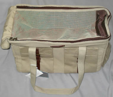 The Safari Carrier has a solid top which can be rolled away, allowing ventilation through the mesh top.