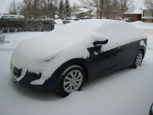 Snow blankets my car - easier to brush it off than to scrape ice!