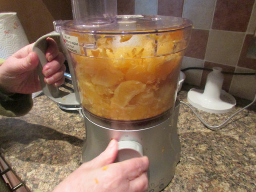 Place the orange segments into the food processor