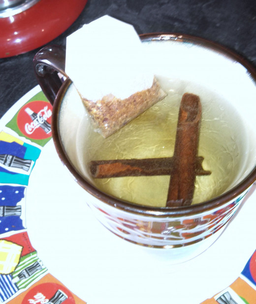 Brewing Tea Using a Tea Bag and Cinnamon Sticks