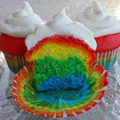 Rainbow cupcakes with white frosting