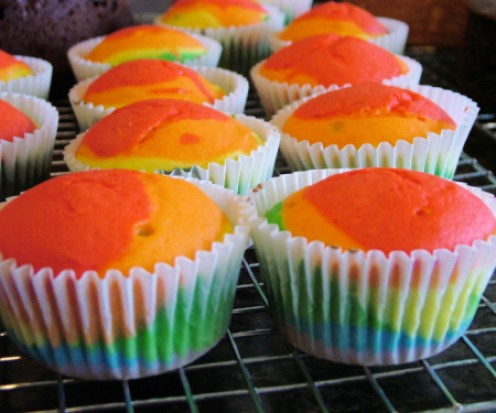 Rainbow cupcakes fresh out of the oven.