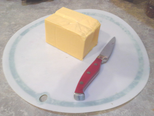 Step Three: Lay half of a 2 pound Velveeta block on your cutting board