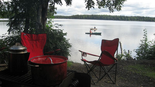 Lakefront campsite with canoes