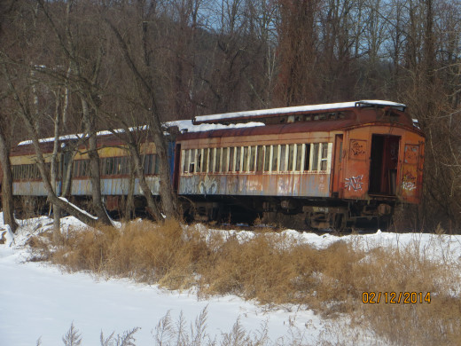 Old train cars resting in peace and outlined with snow.