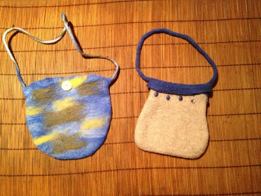 A wet felted purse on the left.  A knitted and fulled purse on the right.