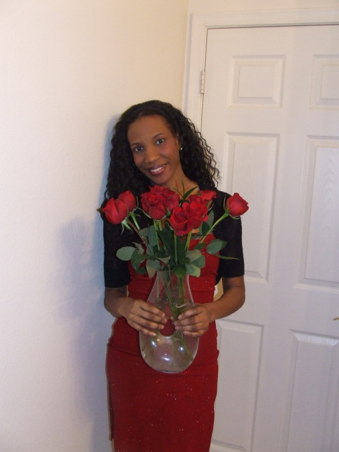 Emunah La-Paz holding roses.
