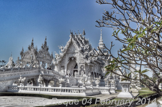Wat Rong Khun, the White Temple, seems like a temple made of snow and ice. Yet, it is not winter the artist wants to symbolize, but purity and the reflection of one's love to others. Location: Wat Rong Khun (The White Temple)