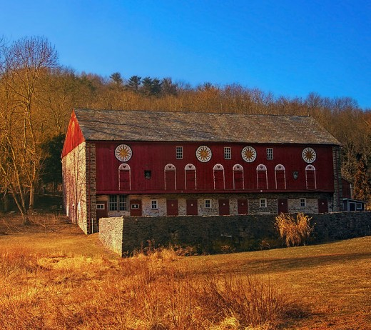 A barn in Berks County, Pennsylvania clearly adorned with Hex Signs.