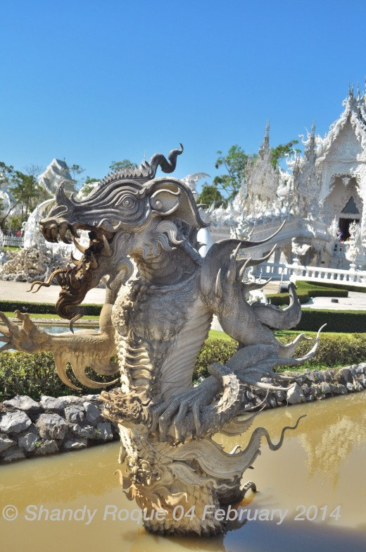 Although it looks cool, it's quite difficult to interpret what this monster symbolizes. Could it be a demon making its way out of hell?  Location: Wat Rong Khun (The White Temple)