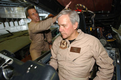 """NBC News Anchorman Tom Brokaw on the operation of an F-14 """"Tomcat"""" ejection seat, March 24, 2002."""