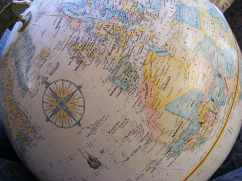 As you can see on this globe, Greenland (upper left) is clearly dwarfed by the North-eastern part of Africa (right)