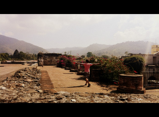 Andy walks on what is left of the top floor of Convento de Nuestra after earthquakes destroyed it.