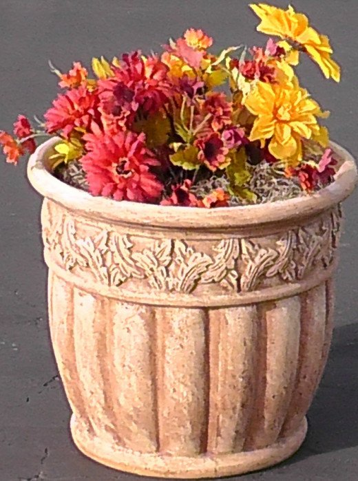 Plant flowers along the front of the house for added curb appeal. Decorative pots are also an easy solution.