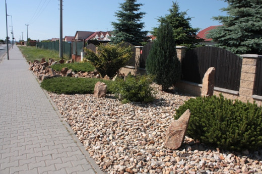 Pebbles can replace grass as a creative way to beautify your landscape.