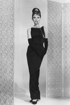 "Famous still from ""Breakfast at Tiffany's,"" great example of that classic Audrey style, a slim fit, floor-length shift.  Gloves are not needed for a modern take!"