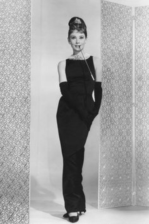 """Famous still from """"Breakfast at Tiffany's,"""" great example of that classic Audrey style, a slim fit, floor-length shift.  Gloves are not needed for a modern take!"""