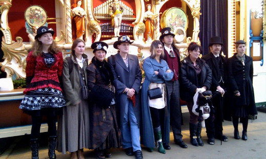 This is a photo I took while in London doing research on the Steampunk genre. These are the wonderful people I met (I'm the fool in red on the far left) including my friends Ben, Kevin and Susie. They've taught me everything I know about the genre.
