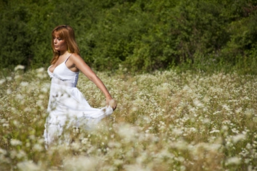 Young Woman in Meadow Stock Photo by adamr ID:10091215