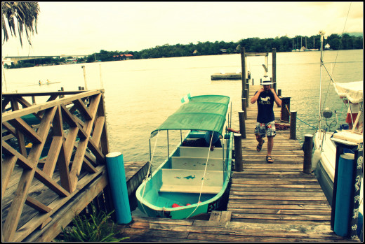 Getting in the lancha at El Tortugal to cruise the Rio Dulce.