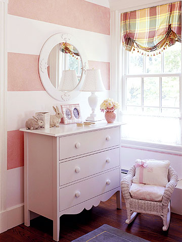 horizontal pink striped walls in a nursery