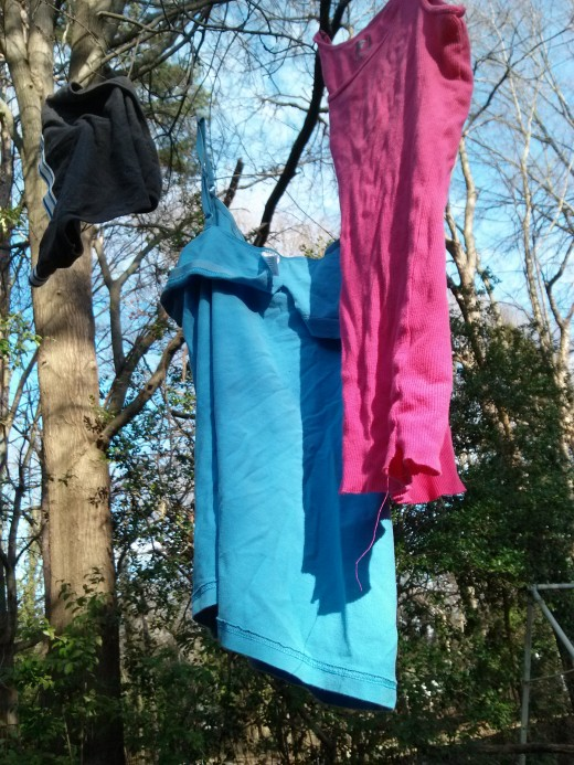 Here are some of my own clothes hung out on the tree branches in my back yard-- drying out in the sunlight.