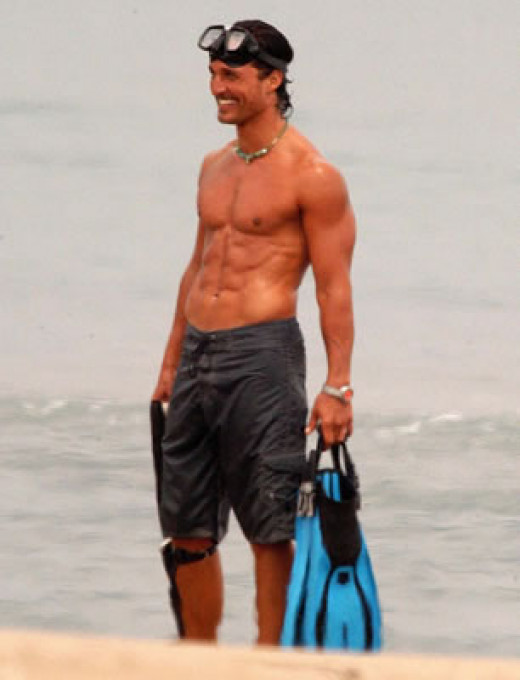"Physically fit Matthew Mcconaughey on a beach with scuba gear, showcasing six pack abs - living his fitness mantra of ""breaking a sweat everyday"""