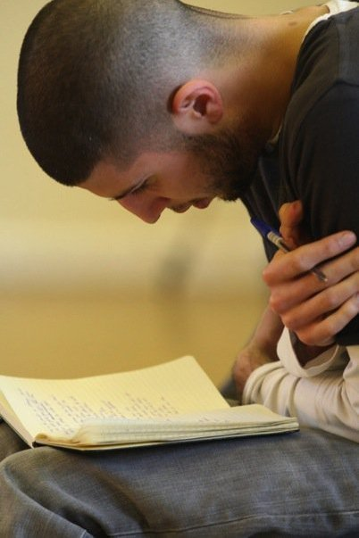 """A man writing poems, """"Taken at the Royal Shakespeare Company."""""""