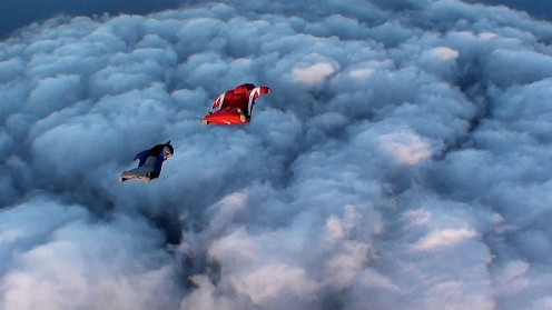 Wingsuit Flyers Over Heavy Clouds