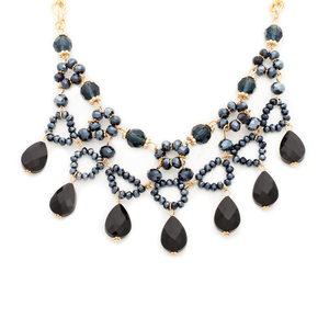 It features of sleek black teardrop beads on a gold chain. Unique in every way, this statement necklace is a jewelry box must-have.
