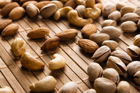 Almonds, cashews, and pistachios have the least amount of fat.