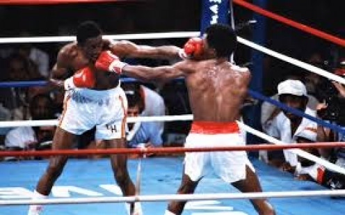 Sugar Ray Leonard and Tommy Hearns trade jabs in their epic first bout in which Leonard rallied to win by 14th round knockout.