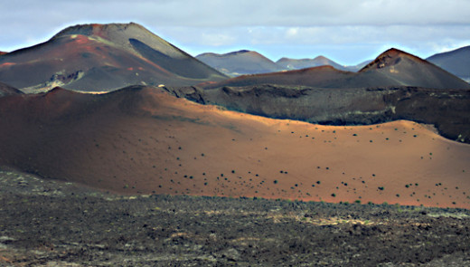 Calderas, cones and multicoloured volcanic rocks make Timanfaya barren, yet attractive