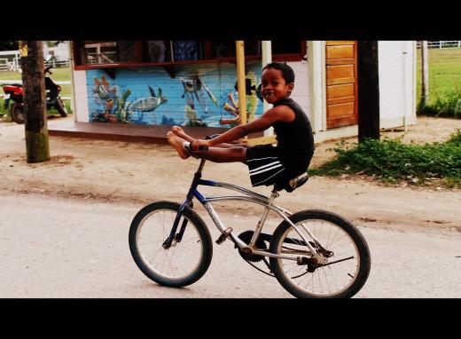 Boy on bike, Placencia