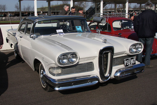 An Edsel is shown being displayed with other antique cars.